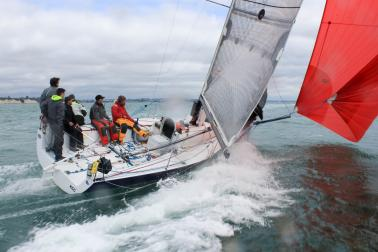 Yachts racing in ocean with large wake